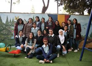 The UNRWA Birzeit Girls' School playground is situated next to the community cemetery. This further underlines the need to create a cheerful and safe environment for the students to enjoy and play. © 2018 UNRWA Photo by Dina Sharif