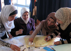 Psychosocial counsellors undergoing training in Damascus, March 2014. UNRWA Archives