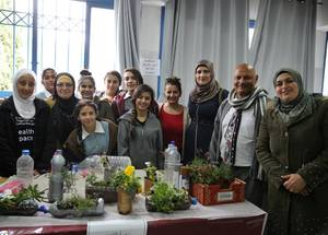 Students from across the West Bank shared the environmentally-friendly projects they worked on throughout the year with Birzeit School principal, Fatmeh Mohammad Shanan (far right), their school counselor Rihan Ahmad Qaimari, and UNRWA West Bank education colleagues. © 2018 UNRWA Photo by Dina Sharif