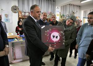 West Bank UNRWA Chief of Education Programme Muaweyah Amar (center) was gifted a painting by students and Birzeit Girls' School principal Fatmeh Mohammad Shanan for his support and encouragement of the initiative. © UNRWA Photo by Dina Sharif