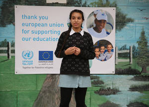 "Fifteeen-year-old Rand Saleh Tabakhna (grade 9) explains to school visitors that ""the goal of this park is to create a good environment for the students, to make them feel like they have a safe space to play and have fun."" The EU-UNRWA Healthy Living, Healthy Spaces initiative has succeeded in its effort. © 2018 UNRWA Photo by Dina Sharif"