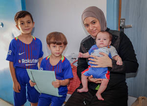 """I have come for a check up on my son Majed, he was born three months ago. My water broke premature, and so UNRWA staff referred me to a nearby hospital for a caesarian,"" says Aliya Faour. Maternal and child health care are part of the services at all UNRWA health clinics. Majed also gets all his vaccinations at the clinic, as do his six-year-old brother Fathi and five-year-old Ahmed. © 2018 UNRWA Photo by Ahmad Abo Zaid"