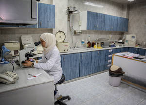 An in-house lab at the UNRWA health clinic in Neirab Palestine refugee camp near Aleppo processes blood samples taken from patients. Last year, UNRWA labs in Syria processed more than 250,000 tests.  © 2018 UNRWA Photo by Ahmad Abo Zaid