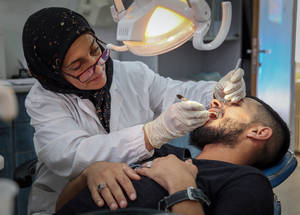 UNRWA provides dental care to Palestine refugees at 20 of its 22 health centres in Syria, as well as in its mobile health units. In 2018, UNRWA carried out more than 100,000 preventative and curative dental consultations. © 2018 UNRWA Photo by Ahmad Abo Zaid