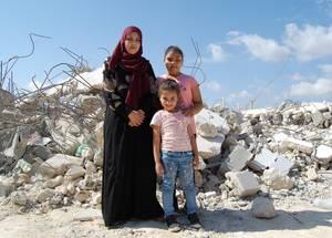 "Shymaa who is a mother of five, is pictured here with two of her daughters, Bissan (11) and Jana (5).   When their family home was demolished back in September 2018, Shymaa was caring for her two-month old son. When UNRWA met with Shymaa last year she expressed her feelings of helplessness and despair and shared fond memories from her now destroyed home:   ""We used to all gather in the garden in our home, light up the barbeque grill and have fun all night."
