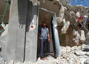 Part 1: Ahmad is seen here standing in what remains of his house in Al-Walajah village after its demolition by the Israeli authorities in September 2018. The lives of Ahmad, his wife Fida' and their three children – Nabil (13), Mayar (12) and Mohammed (8) – were turned upside after the witnessed the demolition of their own home.