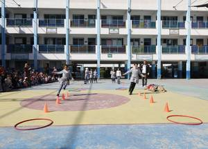 Students at the UNRWA Al-Zaytoun Basic Girls' School compete in a Keeping Kids Cool obstacle course organized by UNRWA across Gaza. © 2019 UNRWA Photo by Mohammed Hinnawi