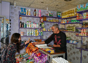 "Ahmed Dreim used to run multiple thriving businesses, including a supermarket, in Ein El Tal camp near Aleppo. But the conflict in Syria changed all that; he was forced to flee in 2012. ""I started in Latakia with nothing,"" he says. ""We left our home with only the clothes on our back.  It took me some time to stand on my feet,"" he says.  He managed to start a supermarket in the camp and took out a SYP 100,000 (US$ 200) SYP loan with UNRWA in 2017. This allowed him to buy more produce to fill up his shelves,"