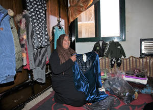"Sabah Saleh al Hussein from Jaramana camp was displaced by the conflict. In 2016, the family moved into a new neighbourhoud, to decrease living costs. ""We were living hand to mouth"" she says. So she decided to start selling women and children's clothes store from her home. She took out a microfinance loan from UNRWA for 20,000 SYP (25 USD). ""I spent it on inventory"" she says. In October 2018 she took out her 6th loan, for 200,000   SYP.  © 2019 UNRWA Photo by Taghrid Mohammad"