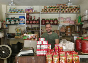 "Fadi Hassan used to run a food shop in Yarmouk camp, but when the camp was destroyed he moved to Sweida.  ""We had to start all over again,"" he says. UNRWA gave him a micro loan in order for him to get back on his feet and open a new business.  ""My first loan was for 400,000 SYP (US$ 1,000), which allowed me to buy stock for my shop. Things are much better now and my business is growing."" © 2018 UNRWA Photo by Fernande van Tets"