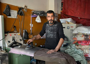 "Yazan opened this laundry shop in 2015.  A year later, after being approached by UNRWA microloan officers, Yazan applied and got a loan for 100.000 SYP. ""My shop was already doing well but it allowed me to buy products I need, like detergent and dye, in bulk, which is cheaper. Thus my profit margin increased,"" he says. He paid off his loan over an 8 month period, and his business continues to thrive. © 2018 UNRWA Photo by Fernande van Tets"
