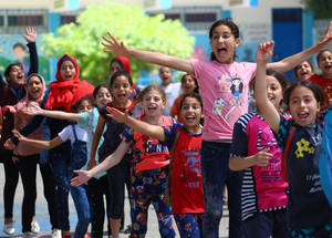 "A group Photo for students participating in art activity in Jabalia elementary Co-Ed school ""B"", under (Keep Kids Active) project implemented in 50 UNRWA schools across Gaza. Photo credit: © 2019 UNRWA. Photo by Khalil Adwan."