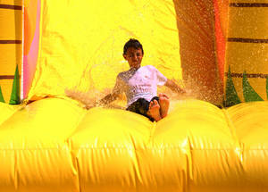 "Student enjoying the waterslide at UNRWA Al- Bureij Prep Boys School ""B"", one of the locations of the Keeping Kids Active project. Photo credit: ©UNRWA Gaza 2019. Photo by Khalil Adwan."