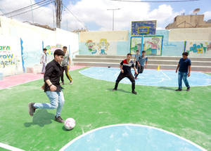 Members of the student parliament of the UNRWA Elementary Boys School in Baqa'a Camp in Jordan try out the new soccer pitch, which was restored as part of the maintenance works of UNRWA installations in its area of operations throughout the Middle East in a project generously funded by the Kingdom of Saudi Arabia thought the Saudi Fund for Development (SDF). #UNRWA #SFD #forPalestine refugees. © 2019 UNRWA Photo by Nader Taha