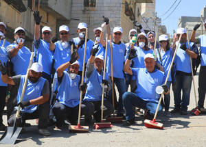 Dozens of UNRWA staff members from the West Bank gathered for the Eid al-Adha Camp Campaign, which included street cleaning and wall painting in Aida refugee camp in Bethlehem. #UNRWA #SFD #forPalestinerefugees © 2019 UNRWA Photo by Abeer Ismail