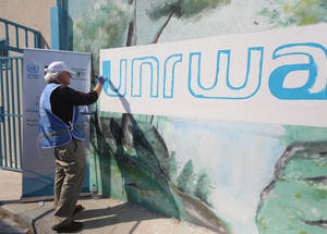 The Director of UNRWA Operations in Gaza, Matthias Schmale, helps to emblazon the wall outside an UNRWA school in the Nuseirat Palestine refugee camp with the UNRWA logo as part of the environmental cleaning campaign taking place in UNRWA installations throughout the Middle East ahead of the Eid al-Adha campaign. The campaign is generously funded by the Kingdom of Saudi Arabia through the Saudi Fund for Development. #UNRWA #SFD #forPalestinerefugees © 2019 UNRWA Photo