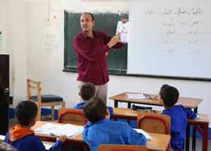 """I love my career and I feel I was born to be a teacher. I am not able to do any other job,"" says Mohammad Qablawi, a fourth-grade teacher at the UNRWA Nahaf School in Jaramana Camp in Syria. Mohammed chose teaching as a career because he believes that his efforts towards his students can be translated into actions when seeing their progress and success in life. ""My role model is my sixth-grade math teacher! He was a strong person, flexible and respectful. He promoted the value of education as a way of building our country and instilled the concept of homeland and love of the country in us,"" says Mohammed."