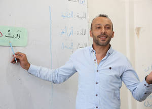 "Mouayad Badwan(مؤيد بدوان)  is a second-grade class teacher at UNRWA Palestine School. ""When I was a student at UNRWA schools in Yarmouk, I admired the teachers who made learning more productive and followed methods that make teaching stimulating and engaging.  A good teacher can inspire hope and instill a love of learning.  My most memorable teachers were the Arabic and social studies teachers. Their creative teaching techniques inspired me. My passion in life is teaching and adding my part to raising a good Palestinian generation,"" he says. Mouayed is passionate, enthusiastic and engaging.  ""Every time that I teach a lesson, I feel students are excited to learn more about the topic and become active learners.""  Mouayad started his career as a teacher at the UNRWA temporary teaching points in the collective shelters for displaced refugees in 2016. ""UNRWA set up teaching points to help slow learners and students who lost out on lessons or were from besieged areas take their national exams,"" Mouayad recalls."