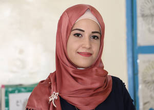 "Aseel Abu-Mahfouz, works as a daily paid maths teacher at the Jofeh Elementary School in Amman, Jordan for two years.  ""In the beginning, the journey was expected to be hard, given that I am still very junior. But, it turned out to be a very joyful experience, especially thanks to the support provided by the school principal, Suhad Asfour. Ms. Suhad introduced me to new teaching methods and explained to me the duties and rights of daily paid teachers. She follows up on my performance and always encourages me to give my best."" Photo credit: Aseel Abu Mahfouz, daily paid Math teacher at Jofeh Elementary School in Amman-Jordan © 2019 UNRWA photo by Daniah Al Batayneh"