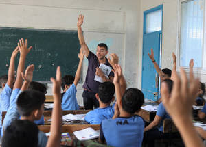 "Waseem Abu Karsh, is daily paid teacher at the UNRWA Zaitoon Preparatory Boys School ""B"". © 2019 UNRWA Photo by Ibraheem Abu Osheba.  ""Time on the job does not ensure professional growth, and successful teachers are those who continue to develop throughout their professional lives. ""UNRWA granted us the chance to receive training that enhanced my teaching skills with new and active learning strategies. I applied what I learned in my classes and share these methods with my colleagues,"" she said."