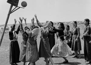 Young women play basketball at the Women's Activity Centre in Kalandia, West Bank, in the 1950s. © Undated UNRWA Archive Photographer Unknown