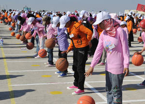 "Young Palestine refugee girls from Gaza joined in the attempt to set the record for most basketballs bounced simultaneously. The event was part of the ""Summer Games"" organized by UNRWA in 2010 involving some quarter of a million children across the Gaza Strip."