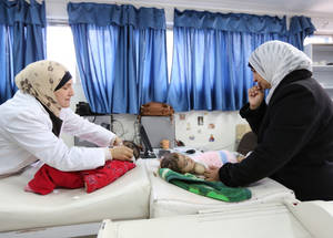 Infant and maternal mortality rates over the past few decades of UNRWA services have been a main focus in the provision of health care. In 2017, out of 8.5 million consultations, 60 per cent were women and girls.  In 2018, the maternal mortality rate stood at 15.8 out of 100,000 live births among pregnant women registered with UNRWA antenatal services. The Agency supported a decline in the neonatal mortality rate – a main indicator of the health of a community – among Palestine refugees from 16 per cent in 1960 to 1.37 per cent in 2017. In this photo, a mother and her two infant children visit the UNRWA health centre in Marka Palestine refugee camp in Jordan for a regular check-up. © 2013 UNRWA PHOTO by Alaa Ghosheh. SDG 3 and SDG 5