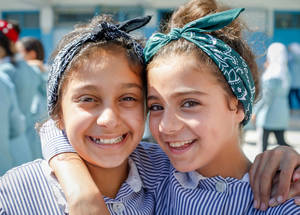 The Agency's education programme has had a transformational impact on four generations of refugee children, particularly for girls, achieving gender parity in its schools long before most national education systems in the region. UNRWA has educated over two and a half million refugee children under a programme recognized as a significant educational force in the Middle East. Currently, 75 per cent of all Palestine refugee students receiving scholarships for university are women. These two girls are students at the UNRWA Jalazone Girls school in the Jalazone refugee camp in the West Bank.  © 2018 UNRWA Photo by Marwan Baghdadi, SDG 4 & SDG 5