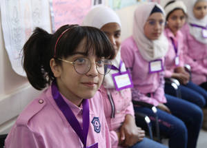 Young school parliamentarians gather for a meeting at their school in the Sbeineh Palestine Refugee Camp in Syria. School parliaments are part of the he Human Rights, Conflict Resolution and Tolerance  (HRCRT) programme pioneered by UNRWA in 1999. The programme ensures that all refugee children, including girls, know the rights to which they are entitled, along with the need to respect all rights universally.  The first school parliaments allowed girls and boys to engage in democratic practices, leadership and networking, thus laying the groundwork for their equal participation in politics and decision-making.  The first Agency-wide parliament was elected in 2017. © 2019 UNRWA Photo by Taghrid Mohammed. SDG 5 SDG 10
