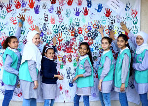 "UNRWA students at the  Rimal Preparatory Girls' School ""A"" participate in 16 Days of Activism Against Gender-Based Violence campaign. The Agency's commitment to the promotion of gender equality and women's empowerment is enshrined in its Gender Equality Policy (2007) and the Gender Equality Strategy 2016-2021. The Agency has also, since 2009, taken a multi-sectoral approach to ending gender-based violence, in addition to addressing the gendered impact of crises and emergencies. In 2018, UNRWA introduced the guidelines on Zero Tolerance for sexual exploitation and abuse, thus, taking an important step toward ending sexual harassment and violence. © 2019 UNRWA Photo by Ibrahim Abu Usheiba. SDG 5 SDG 10 SDG 16"