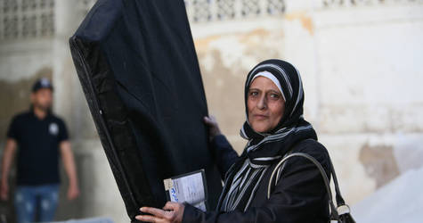 Sixty-year-old Hanane fled her house in Yarmouk five years ago with her family. She now lives in Aqraba, Damascus, in a small rented house. For this mother of five, the mattresses distributed by UNRWA are a basic substitute for the furniture she can't afford. Alliance distribution centre, Damascus. © 2016 UNRWA Photo by Taghrid Mohammad