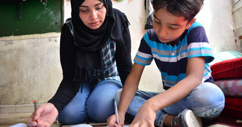 Tabreez and her family, like thousands of Palestine refugees, have been displaced multiple times in Syria. Unable to afford housing costs, she and her sons live today in the UNRWA Haifa School collective shelter. UNRWA Haifa School collective shelter, Damascus, Syria. © 2017 UNRWA Photo by Taghrid Mohammad