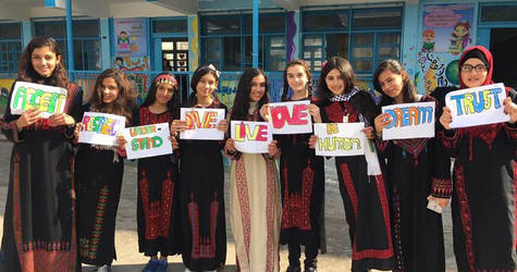 In Gaza, Nadine and her classmates became strong advocates of 'values-based education', through which they decided to promote awareness about cultural diversity and global citizenship. At school, they established themselves as ambassadors for respect, tolerance and acceptance and organized a school festival celebrating other countries' costumes and traditions. © 2017 UNRWA Photo