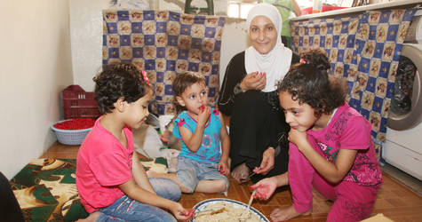 During Ramadan, the common practice is to fast from dawn until sunset. The pre-dawn meal before the fast is called suhour, while the meal at sunset that breaks the fast is iftar. Ramadan is also the time when families and loved ones share meals.  Jaramana camp, Damascus, Syria. © UNRWA Photo by Taghrid Mohammad