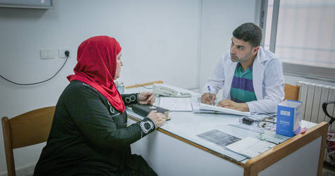A patient visits the UNRWA health centre in Neirab Palestine refugee camp near Aleppo. In 2018, UNRWA carried out more than 840,000 health consultations. © 2018 UNRWA Photo by Ahmad Abo Zaid