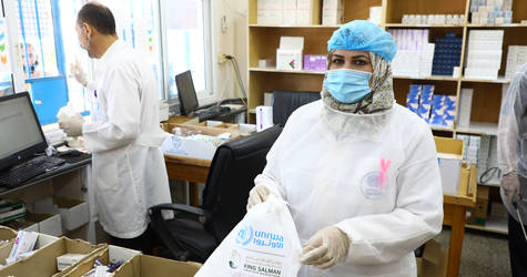 Amal Abu-Musa, a practical nurse in UNRWA Khan Yunis Health Centre, prepares medication for home delivery to Palestine refugees in Gaza. © 2020 UNRWA Photo by Khalil Adwan