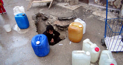 The surface of this road was dug up to allow access to water in Yarmouk. © UNRWA Photo by Rami Al-Sayyed