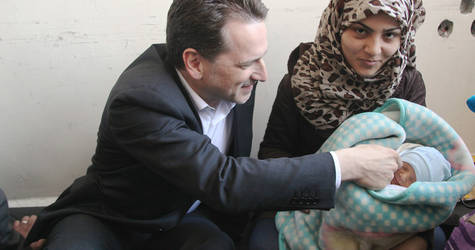 Mr. Krähenbühl heard the personal stories of the civilians displaced from Yarmouk. Tiny Jihad Ya'qoub was born on 30 March 2015; he and his mother have received a baby kit and other essential household items from UNRWA. © 2015 UNRWA Photo byTaghrid Mohammad