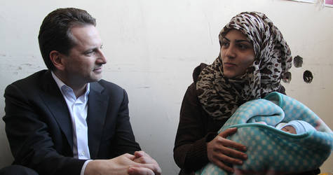 On 11 to 12 April, UNRWA Commissioner-General Pierre Krähenbühl undertook an emergency mission to Syria. During his visit, Mr. Krähenbühl heard the personal stories of the civilians displaced from Yarmouk. Tiny Jihad Ya'qoub was born on 30 March 2015; he and his mother have received a baby kit and other essential household items from UNRWA. © 2015 UNRWA Photo by Taghrid Mohammad
