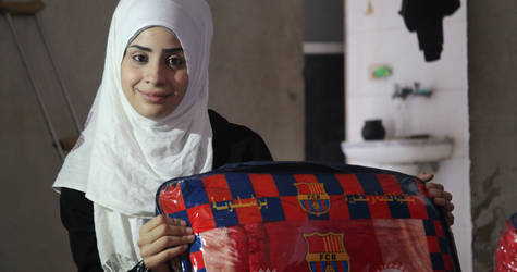Ghufran Azeemeh in her shop in Jaramana. © 2015 UNRWA Photo by Taghrid Mohammad