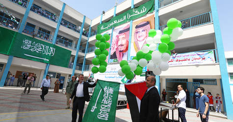 Director of UNRWA Operation Gaza, Mr. Bo Scahck  with Senior External Relations and Projects Officer Mr. Munir Manneh flying the flags of Palestine and the Kingdom of Saudi Arabia during the opening ceremony of Jabalia elementary girls' school (A&B)  funded by the Saudi Fund for Development (SFD). Photo credit: ©UNRWA Gaza 2016. Photo by Tamer Hamam.