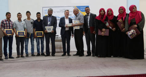 Director of UNRWA Operations in Gaza, Bo Schack (middle), with the two teams of innovators from the Gaza Training Centre, during the honouring ceremony. © 2016 UNRWA Photo by Mohamed Al Hinawi