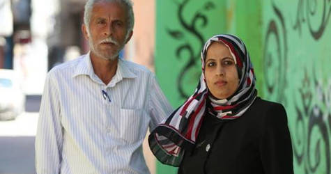 Mohamed Geith and his daughter Ilham, standing in front of their house in Beach camp. © 2016 UNRWA Photo by Mohamed Al Hinawi