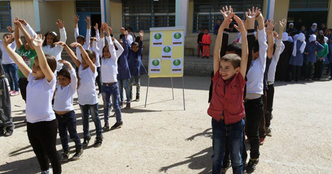 Students from a school in Baqa'a, Jordan, exercising as part of the healthy lifestyle campaign promoted by UNRWA. © 2016 UNRWA Photo by Sawsan Al-Alem