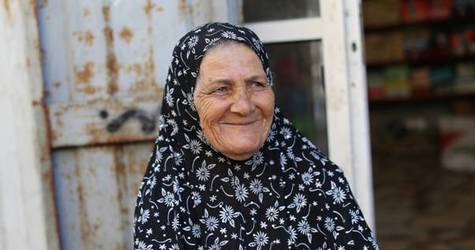 Seventy-five-year-old Palestine refugee Jamila Hashisho sitting outside her home in Beach camp, in western Gaza City. © 2016 UNRWA Photo by Tamer Hamam