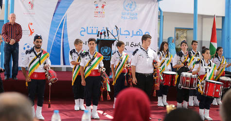 Orthodox scouting performing the Palestinian anthem during the opening ceremony of UNRWA 2016 Summer fun weeks at Al Zaitoun preparatory girls school (B) Photo credit: © UNRWA Gaza 2016. Photo by Tamer Hamam.