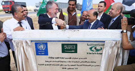 The Director of UNRWA Operations in Gaza, Mr. Bo Schack, the Palestinian Minister for Public Works and Housing, Mr. Mufeed Al Hasyna and UNRWA Senior External Relations and Projects Officer, Mr. Munir Mannah, are placing the cornerstone for the construction of UNRWA's largest logistics base in Gaza, located in Rafah, southern Gaza. Photo credit: ©UNRWA Gaza 2016. Photo by Tamer Hamam.