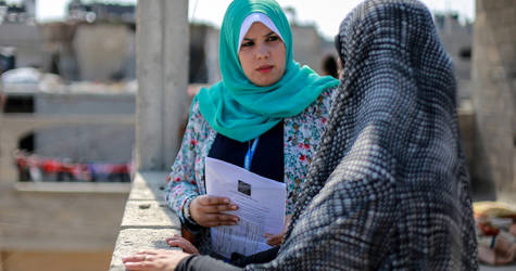 27-years-old Haneen Atallah is speaking to an UNRWA beneficiary in her home in Beit Hanoun, northern Gaza. © 2016 UNRWA Photo by Rushdi Al-Saraj