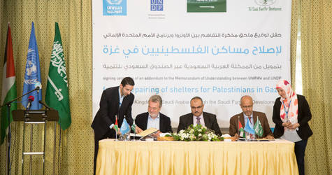 Director of UNRWA Operations in Gaza, Mr. Bo Schack, and UNDP Special Representative of the Administrator, Mr. Roberto Valent, during the signing ceremony of the amendment to the MOU between UNRWA and UNDP on repairing shelters for Palestinians in the Gaza Strip with generous support from the Kingdom of Saudi Arabia through the Saudi Fund for Development. © 2017 UNRWA Photo by Tamer Hamam