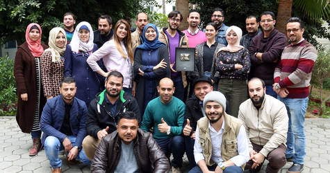A group photo of the UNRWA TV team with the YouTube Silver Play Button. © 2017 UNRWA Photo by Tamer Hamam